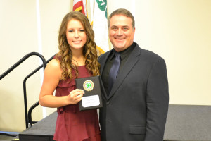 Lindsey Tarby is presented the Gold Star award by Collin County Extension Agent Chris Schraeder.