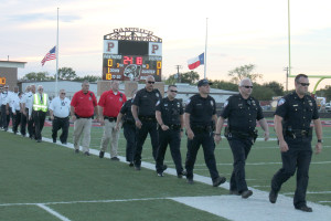 First responders walk onto the field during the 9/11 ceremony to applause and a standing ovation.