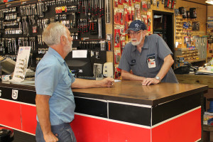 Big G Auto Supply and Hardware manager Eddie Grigg waits on a customer. Grigg has been with the store since it opened in September 1985.
