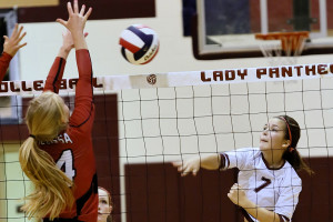 Princeton's Astraea Wayman tries to score a point as Melissa's Riley Duzenack defends the net during a District 12-4A match. For additional photos and the story see this weeks Sports.