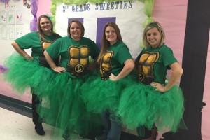 3rd grade teachers from Godwin Elementary School  Jennifer McClellan, Katie High, Jenni Christensen and Meagan Turner show off their inner Teenage Mutant Ninja Turtles.
