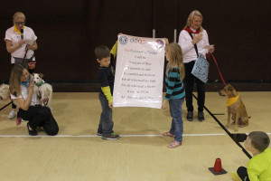 Traits to embody to be a good student to others are presented at Lacy's Dog of Character program.