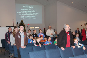 Children and adult volunteers sang Christmas carols Saturday as part of a Christmas Vacation Bible School conducted by Faith Baptist Church of Princeton.