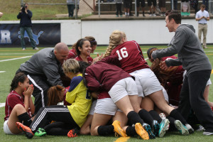 Lady Panthers and coaches celebrate following a 3-2 win over Mabank in the Class 4A Region II semifinals at Tyler's Rose Stadium.