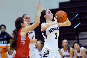 Raygan Cook gets ready to shot from midcourt as the first period expires against Ponder.