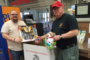 Brandon and Steve Deffibaugh collect toys from drop off points for the Marine Corps League of Collin County's involvement with Toys for Tots.