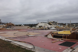 A former game room sits destroyed on Hwy. 380 after an EF2 tornado touched down in the Farmersville and Blue Ridge area.
