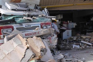 A Pierce Fire Engine sits in debris at the Farmersville Dairy Queen after it drove though the building.