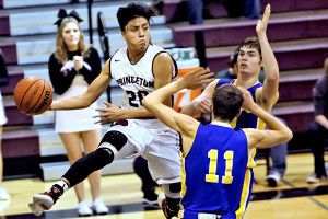 Steven Molina looks for a teammate under the basket against visiting Paris North Lamar in predistrict play.