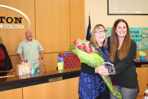 Fifth grade science teacher Amber McIntyre received the  Pride Corps induction for Smith Elementary School. She is the lead teacher for fifth grade at Smith. Giving her flowers is Principal Jona Boitmann.