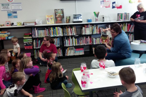 """On Thursday, Feb.11, Lois Nelson Public Library hosted a """"Special Valentine's Story Time"""" for children of all ages with guest reader was Lisa Caldwell, a PISD School Board member.  Special music was led by Library VolunteerRebecca McKinney.  There were 14 children who attended this event and a great time was had by all making Valentine's candles for their loved ones and enjoying Valentine snacks."""