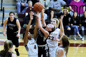 Shay Veal fights for a loose ball against Sanger's Breanna Henderson during the area round at Heritage.