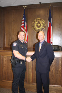 Police Chief James Waters shakes hands with Assistant Police Chief Jerry Varner after he is sworn into office March 21.