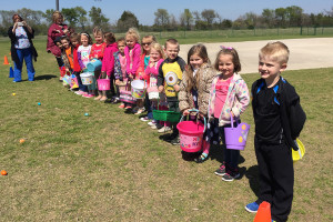 Kristi Foster's pre-K class gets ready to hunt for eggs at Godwin Elementary School. High school students from the National Honor Society hid eggs for the students and played with them on the playgrounds.
