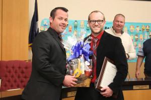 "High School Principal James Lovelady presents a ""man-bouquet"" to High School Teacher of the Year Jason Brown."