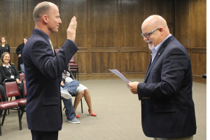 Left, Jerry Varner is sworn into office as Assistant Police Chief by Mayor John-Mark Caldwell March 21.