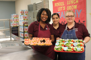 Godwin Elementary School cafeteria workers Kathe Craddock, Deanna Ponse, Enidh Aguirre prepare fresh fruits and vegetables as part of the lunch program's new iniatives to provide better food for students. For more photos see page 6A.