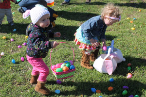 McKenna McAfe shows off her Easter 'ears' while hunting for eggs with her friend Taylor Lindstrom. For more egg hunt photos see page 8A.