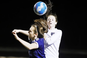 BriAna Lacey goes up against Paris midfielder Laney Madding in a battle for an airball during district action.