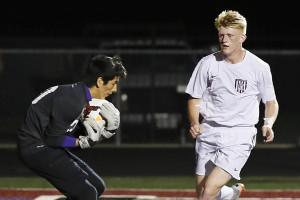 Jacob Purdon rushes toward the Bonham goalie during the district finale at Jackie Hendricks Stadium in Princeton.