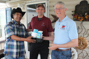 Princeton resident Johnny Delsantos, left, receives a hot meal from Deputy Mayor pro tem David Kleiber and Meals on Wheels driver Roger Hogarth. About 40 Princeton area residents receive hot meals daily through the program.
