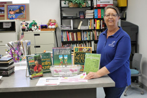 Princeton Library Manager Kathy Dunkel shows off a display of gardening books and free wildflower seeds she created in conjunction with a beautify Princeton effort this month.