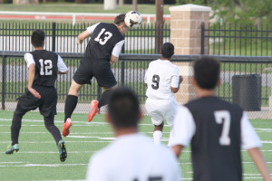 Byron O'Daniel heads the ball away from his goal against Ferris in the Class 4A Region II area round at Terrell.