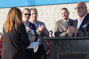 Mayor John-Mark Caldwell, along with city council and city staff members, present a key to the city to Walmart manager Regina Langley.