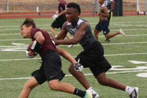 Princeton's Kai Brinkerhoff can't elude a Wylie East Raider during the opening week of the Wylie East 7-on-7 League at East High School. Other teams in the league are Allen, East and Rockwall-Heath.