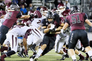 George Flores looks for running room against Athens in the playoffs.