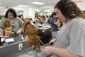 Cosmetology student Brittany Edwards practices styling hair.