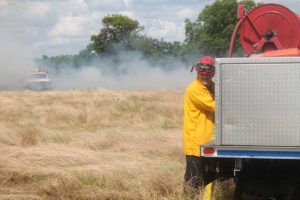 Princeton Fire Captain Steve Gammons aids in refilling a brush truck during a 20-acre grass fire. Princeton FD has made many strides this year to transition to a combination paid/volunteer department.