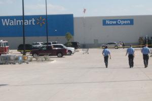 Paramedics walk towards a multiple stabbing at Walmart July 13.