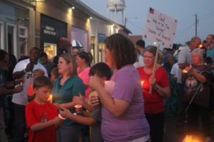 Community members come together Sunday, July 10 in front of the Princeton Police Department in support of officers after the Dallas PD ambush.