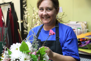 Jayme Cantu, owner of Princeton Flower and Gifts, makes a floral arrangement.