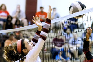 Princeton's Laura Staley blocks a Denton Braswell hit at the net during the Golden Chick Classic at Clark Junior High. For the tournament wrap up and additional photos see this week's Sports.