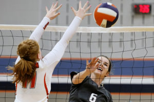 Princeton's Laura Staley wins the battle at the net against McKinney North's Annie Larcom during the third set of a non-district road match. For the story and additional photos see this week's Sports.