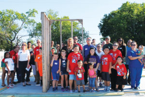 A crowd of North Collin County Habitat for Humanity representatives, family and well-wishers turned out for a wall-raising ceremony to start construction of a house in Princeton for the Sandy Escamilla family.