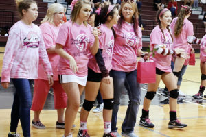 Members of the Princeton volleyball program and cheerleaders honored breast cancer survivors last Tuesday during Dig Pink Night against Melissa. For additional photos from the District 11-4A match see this week's Sports.