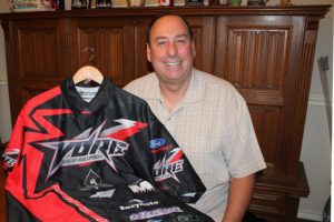 Showing off his VORE racing team jersey is Rick Purcella of Princeton, driving again this year in the Baja 1000.