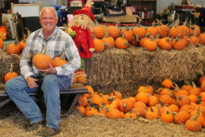 Robert Garner, owner of Old Rooster Creek Flea Market, is giving away free pumpkins to the young and old.