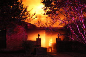 A fully involved house fire occurred overnight Oct. 3 at 223 W. Willow Lane. Human remains were found in the structure after the fire.