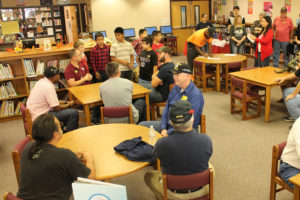 Military veterans visited in the Lacy Elementary School library prior to a Veterans Day program, and gathered again after the program for a reception.
