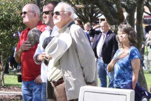 Mike Woody (from left), Princeton Police Chief James Waters and J.M. Caldwell Sr. salute the American flag during the Nov. 11 Veterans Day ceremony at Veterans Memorial Park.