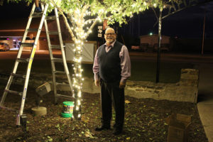 Veterans Memorial Park is aglow with Christmas lights for the first time courtesy of the city. Above, Mayor John-Mark Caldwell supervises the project.