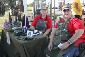 Becky Morrow, left, and Cordie Everman, owner of American Past Tents share their story and their wares made from Vietnam era tents recently at the Princeton Fall Festival.