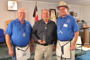 Masonic Lodge Chaplain Steve Deffibaugh, left, helps present City Manager Derek Borg with a Community Builder award along with Princeton Masonic Lodge Worshipful Master Randy Jones.