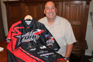 Showing off his VORE racing team jersey is Rick Purcella of Princeton, who finished the Baja 1000 race. Herald photo.