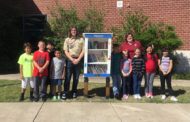 Scout lends a helping hand with little library