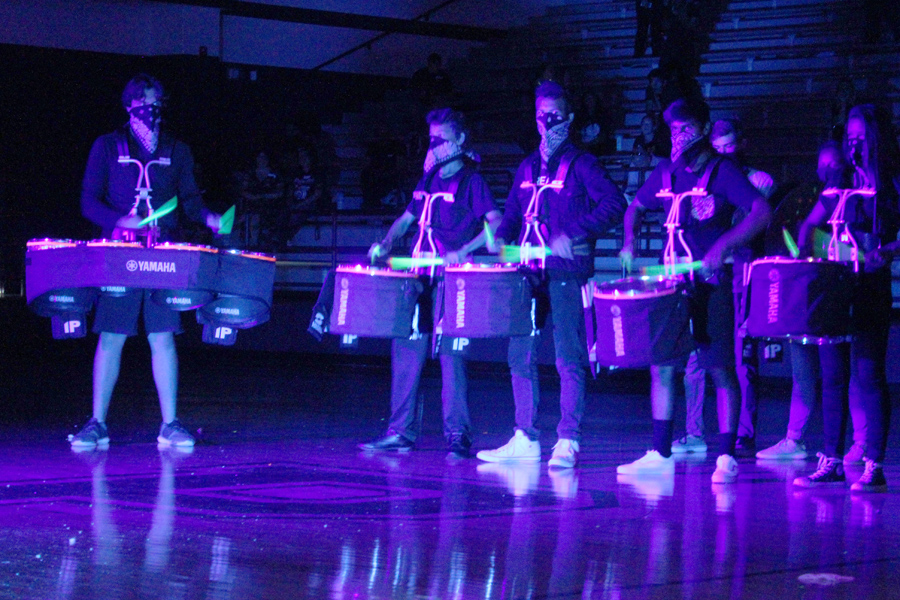 Video: School spirit shines during black light pep rally